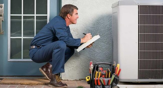 Air Conditioning Contractor Performing AC Maintenance